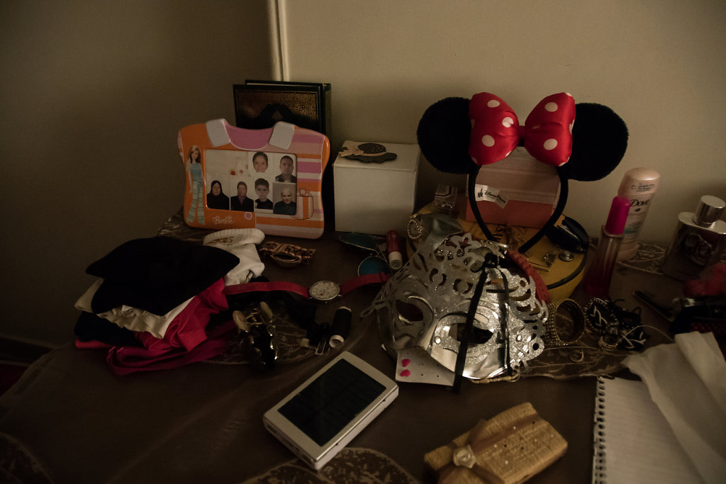 Photos of Leena's family members, including her grandparents, who are still in Syrian and whom she has not seen in years, are displayed on her desk in her room. Leena is not interested in going back to Syria, because she says everything there has changed,