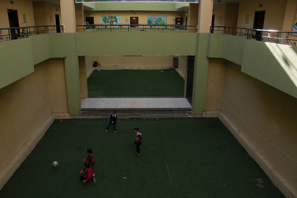 Gyath, Leena's little brother, plays football with his friends after school.