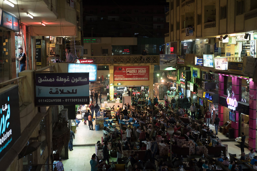 The Syrian street is busy with visitors in the evening.