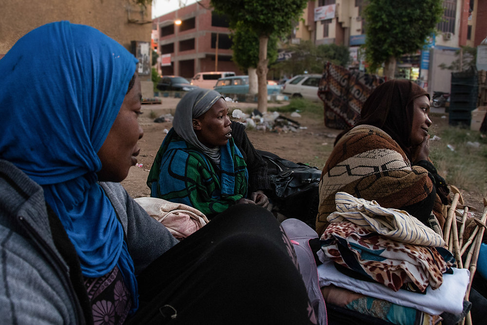 Nawal, Sara, and Mona, all of whom had spent some time living in the garden, sit together after folding up some laundry. Conversations often revolved around the UN paperwork, food, gossip, and work experiences.